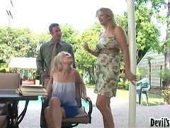 Lovely milf is teaching her daughter how to give a blowjob.