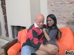 Brunette shemale Dulce C gives a blowjob and gets her asshole banged