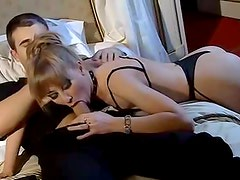 Perfect woman in perfect lingerie sucks his cock
