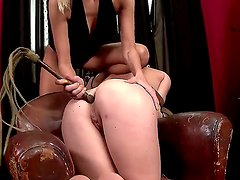 Mistress Clara G is giving worthless slave Tiffany Doll a hard  anal fisting after whipping her ass