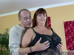 This fat babe in black corset enjoys this dudes huge cock