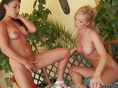 Jewel A and Silvia Saint play with each other's pussies outdoors