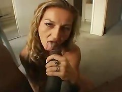 Milf down on her knees blowing big black cock