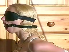 Sweet slender blonde with mask on her face