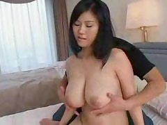 Slowly fondling her huge natural Japanese tits