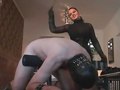Brunette bitch is torturing her sex slave
