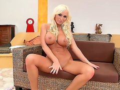 Sexy and gorgeous blonde Viktoria Sweet opens her pussy and rubs it with her fingers
