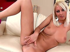 Awesome and buxom Pamela Blond rubbing her ultra-wet pussy with a dildo