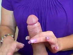 Pretty wife gives erotic handjob