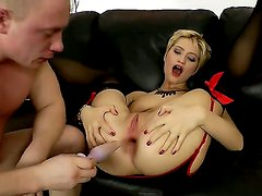 Blonde hottie Janet Mercury enjoys having a huge dildo pounding her tight ass