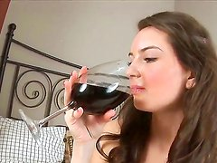 Innocent looking babe Haley gears up with a glass of wine and showing her panty pussy!