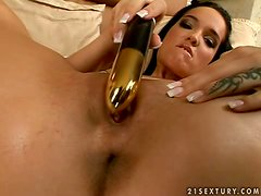 Charming and petite brunette babe masturbates