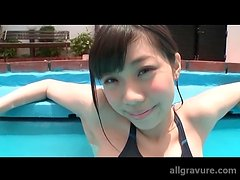 Japanese cutie in the pool in a sexy swimsuit