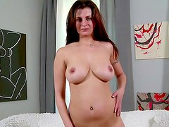 Busty model loves her shaved pussy