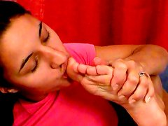 Sensual dark-haired angel is sucking her feets