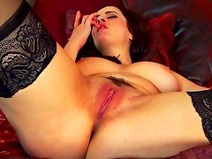 Big-titted brunette Taylor Vixen is sucking her nipples