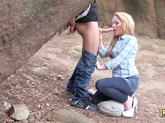 She gives a sensual outdoor blowjob