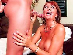 Tapping the cunt of the busty milf