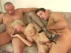 Skinny blonde in fishnets fucked in a threesome