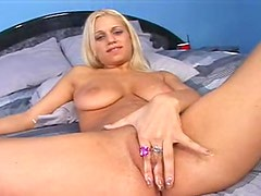 Blonde girl plays with her big natural tits