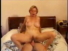 Mature blonde gives a blowjob and gets fucked in cowgirl position