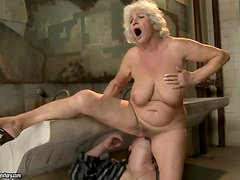 Lewd granny Norma moans loudly while getting her snatch licked and fucked