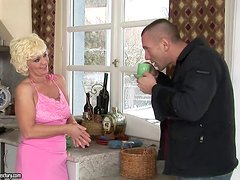 Lustful granny Orhidea enjoys some naughty banging in the kitchen