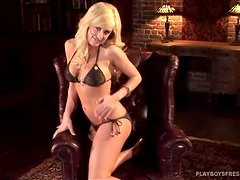 Booty and busty blond Brittany Lynne gets naked in the bar
