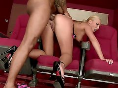 Blonde babe Lisa gets fucked in the asshole by a hot black man in the cinema