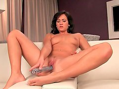 Alluring brunette Tess Lyndon plays with her body