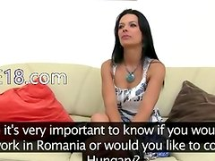 Brunette with big breasts on ottoman