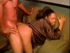 Black guy wields his cock hard in the retro clip