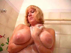 Blonde babe gropes her big natural tits in shower