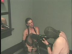 Sub guy licks the latex boots of his sexy mistress