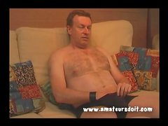 Thick mature guy jerks off while watching porn