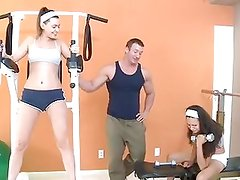 Young brunette has screaming orgasms on weight equipment