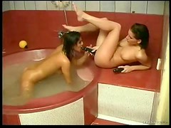 Bathtub hotties use their toys for a thrill