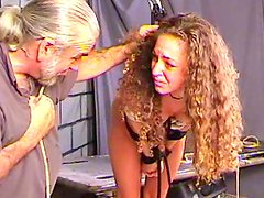 Curly brunette is getting hanged by an old fart