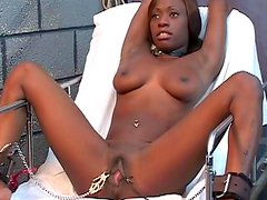 Perverted black babe being fucked in her stretched pussy