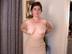Mature brunette shows off her flabby tits and bushy cunt