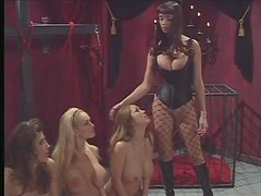 Mistress ties up three big breasted sluts in dungeon