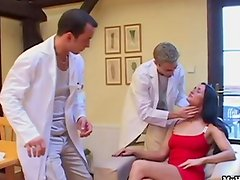 Sandra Kay sits in the doctors office being examin
