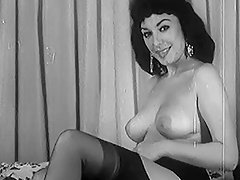 Erotic Bigtitted black haired Bares it All