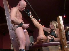Dirty mistress Nicolette ties up her brutal slave's shaved balls