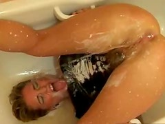 Creamy enema makes a mess on busty girl