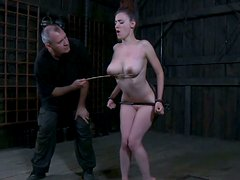 Gorgeous babe Iona Grace is locked to the stone fence
