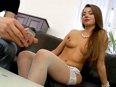 Chick in stockings Roxy Bell provides a cock with a tender handjob