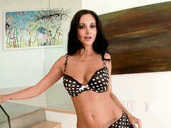 Magnetizing porn actress Ava Addams squeezes her boobs in a solo video