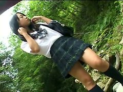 Serious busty student Rui Yamashita demonstrates her boobs outdoors