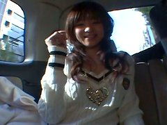 Nasty teen bitch Aimi Nakatan is pleasured in a car